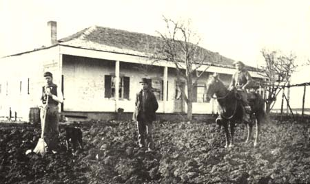 Boronda Adobe about 1887. Pictured are some of the family of William Anderson and Ines Boronda de Anderson, daughter of Eusebio. Courtesy of Monterey County Historical Society.