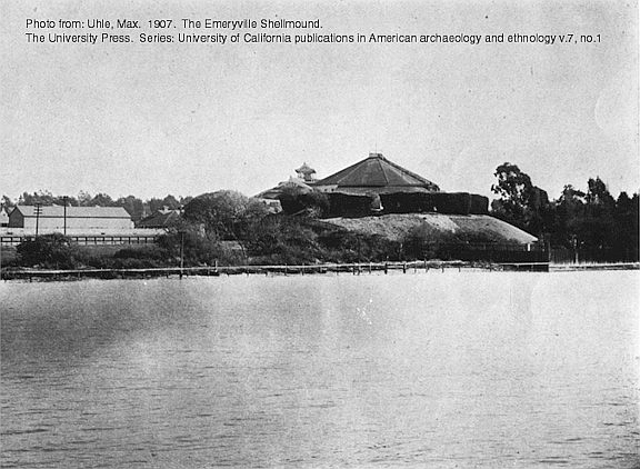 1902 photo, published 1907, of the Emeryville Shellmound with the historic shellmound park dance pavilion built on top. The shoreline of the San Francisco