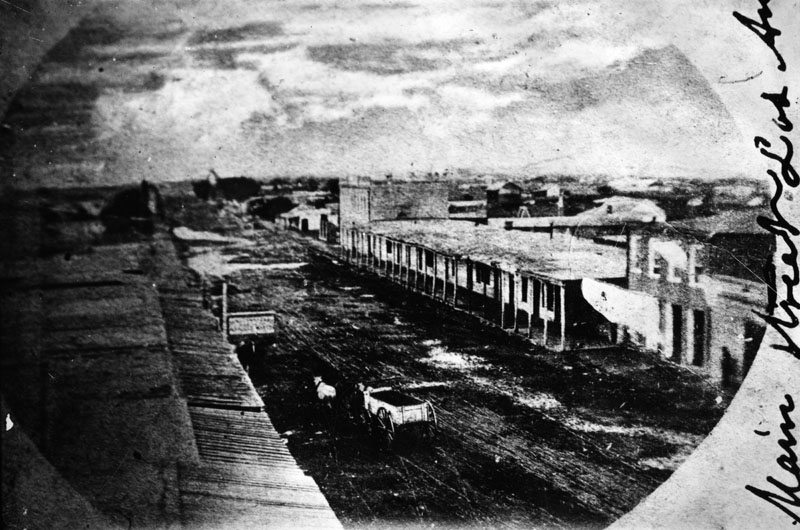 Temple Block adobe buildings on Main Street in Los Angeles in 1868.