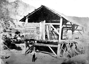 James Marshall standing in front of Sutter's Mill.