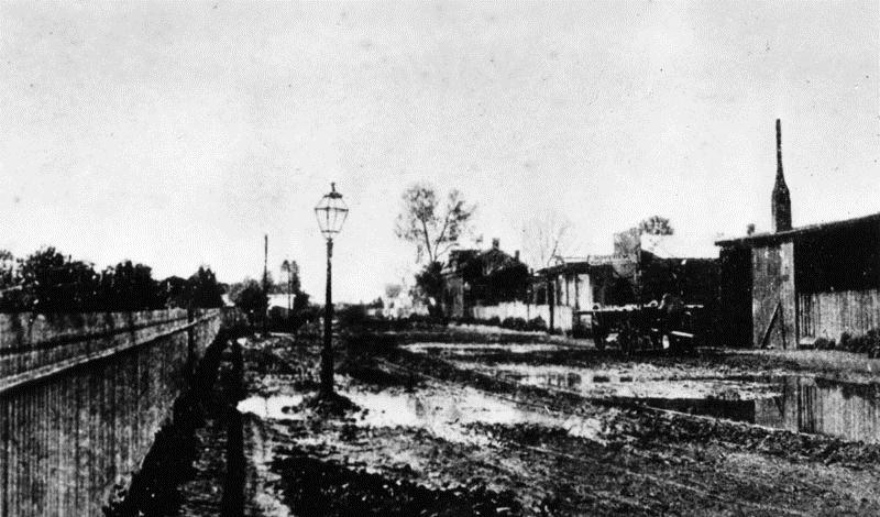San Pedro Street, (Los Angeles?) a muddy dirt street near 2nd Street in the early 1870s.