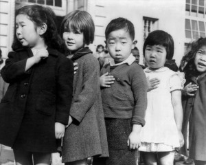Japanese American children pledging allegiance to the flag. Photo by Dorothea Lange (March 1942).