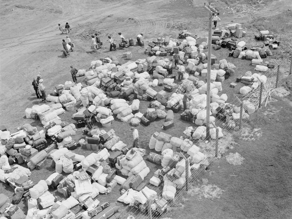 Salinas Assembly Center. Evacuees of Japanese ancestry identify their luggage (1942).