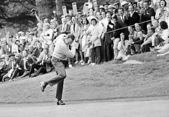 Billy Casper reacts after running a 25-foot putt into the cup at the U.S. Open (1966).