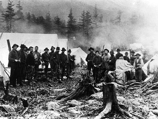 London is thought to be the young man at the forefront of the group on the right. The men are at Sheep's Camp, a resting place a few miles from the arduous Chilkoot Pass.