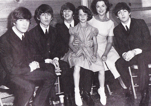The Beatles backstage at the Cow Palace with Shirley Temple Black and her daughter (1964).