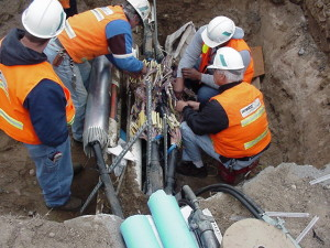 Cut fiber optic cables being repaired.